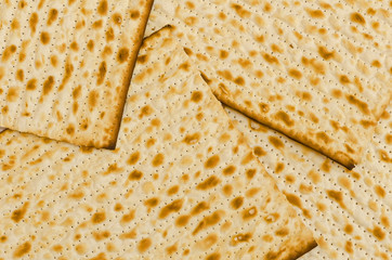 a group of rectangular Matzot, the traditional Jewish bread