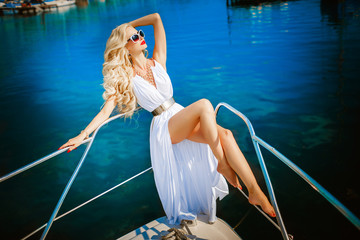 Sexy galmour woman on yacht