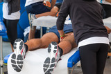 Photo: athletes relaxation massage before sport event