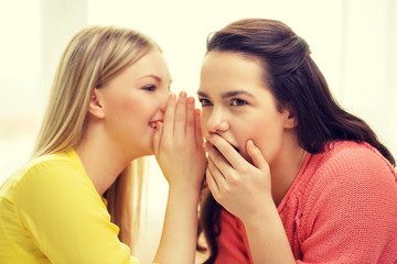 one girl telling another secret