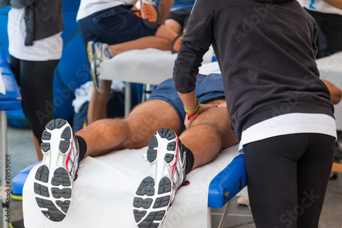 Fotobehang Sportwinkel athletes relaxation massage before sport event