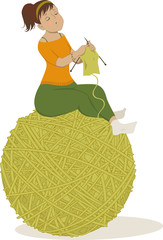 Woman knitting sitting on a ball of yarn