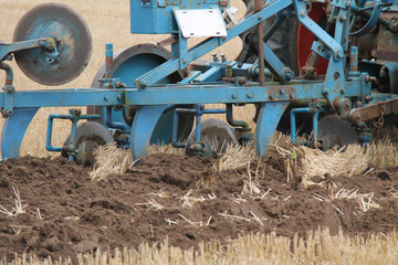 A Classic Agricultural Plough Cutting a Deep Furrow.