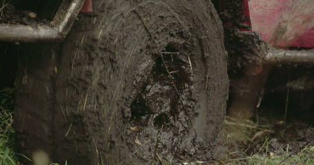 Turning wheel of a 4x4 offroad vehicle on the mud