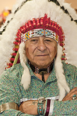 Native American Man Wearing authentic Headdress