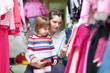 child with mother at clothes store