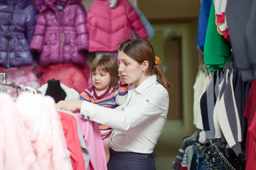 mother and  girl at clothes shop