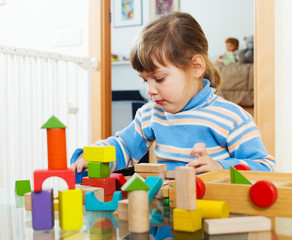 serious child playing with toys