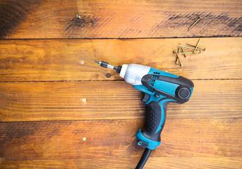 Drill left on wooden floor