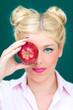 canvas print picture - Blonde Frau mit Apfel in der Hand