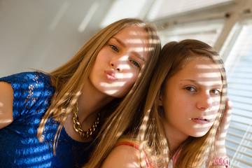 2 beautiful sisters teen girls having fun