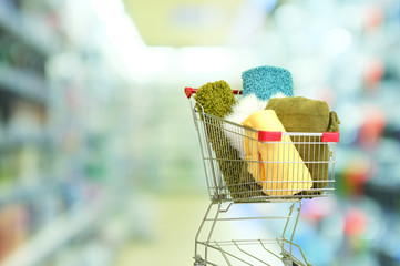 Shopping concept. Shopping cart with colorful carpets and