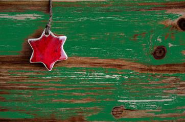Kleiner Stern auf Holz