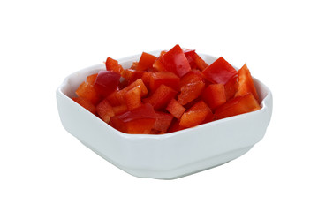 Chopped red pepper in white bowl