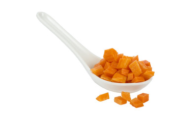 Chopped carrots in a white spoon