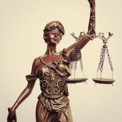 Themis goddess or lady justice holding scale blindfold