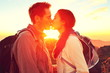 Kissing couple romantic at sunset
