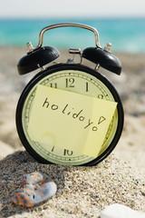 Time clock alarm clock at sunny beach