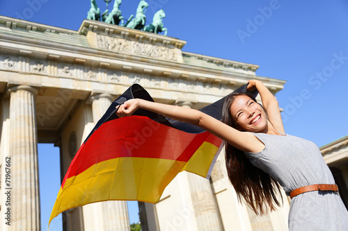 canvas print picture German flag woman happy at Berlin Brandenburg Gate