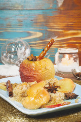 Baked apples in rustic setting served for Christmas