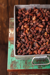 roasted cocoa chocolate beans in Vintage heavy cast aluminum roa