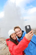 Iceland tourists selfie photo by Strokkur geyser