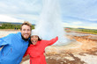 Iceland tourists fun by Strokkur geyser