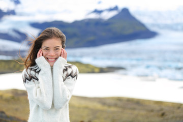 Asian woman portrait sweater by glacier on Iceland