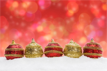 Christmas balls in snow, background with bokeh