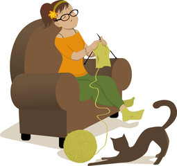 Woman knitting and cat playing with a ball of yarn