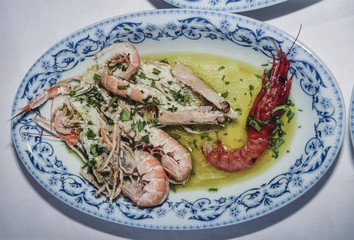 Italy, Sicily, sea food, cooked prawns with garlic and parsley