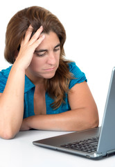 Stressed woman looking at her computer isolated on white