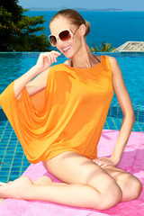 Smiling Pretty Woman in Orange Summer Outfit