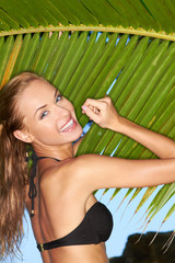 Happy Woman in Bikini Posing at Palm Leaves