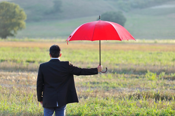 insurance and protection concept, businessman with umbrella
