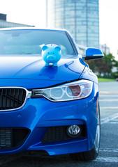 car with piggybank on hood
