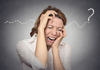 question stress desperation woman overwhelmed on grey