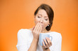 sleepy yawning woman holding cup of coffee on orange background - 71971880