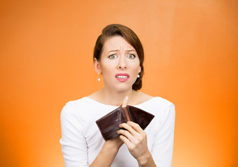 unhappy business woman showing empty wallet broke