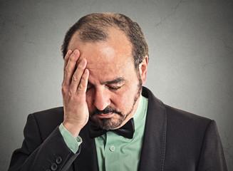 Headshot sad, depressed, alone, disappointed upset man