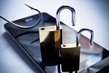 mobile phishing concept - a fish hook on a smart phone