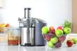 Apple juice on juicer machine - juicing