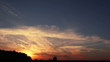 Sunset  with beautiful romantic clouds. Time lapse
