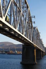 Railroad bridge winter river