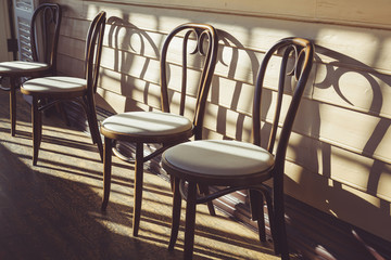 Wooden chairs in cafe terrace