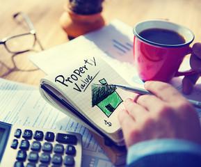 Businessman Notepad Property Value Concept