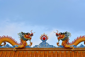Two Chinese  Dragons status on roof of joss house