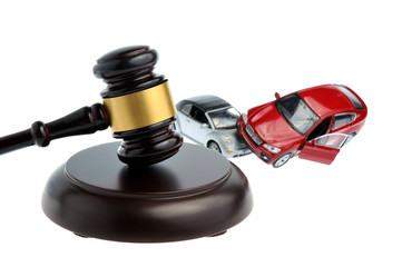 Hammer of judge with models of car accident isolated on white