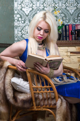 Luxurious blonde woman in a blue dress