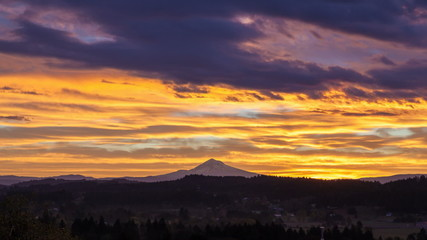 Time Lapse of Sunrise and Clouds with Mt Hood in OR Closeup